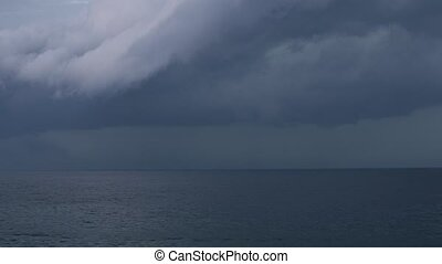 Large storm over the sea with lightning and boat