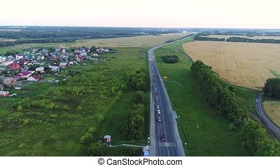 The drone flies over the motorway.The view from the top. -...