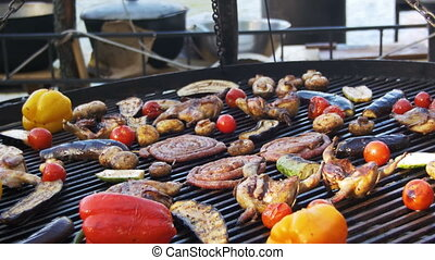 Cooking of Sausages and Vegetables on the Grill