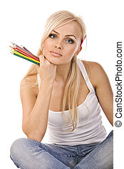 very beautiful blonde with a bunch of colored pencils on...