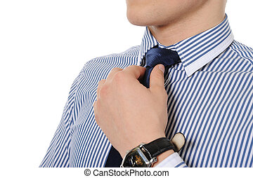 picture of a business man adjusting his tie. Isolated on...
