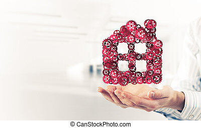 Symbol of homepage or accomodation made with cogwheels...