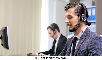 Company workers using headset to talk on the hot line