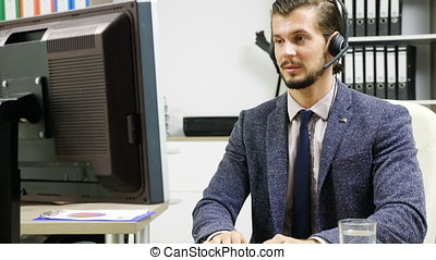 Company workers in suit using headset to talk on the hot...
