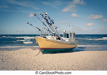 Old fishing boat on a beach