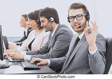 customer service representative with headset showing sign...
