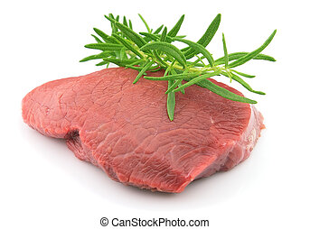 Beef with twig of rosemary