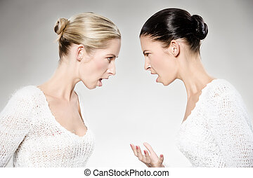 women arguing - two young caucasian women arguing, studio...