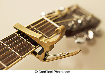 Guitar Capo - An image of a capo for a stringed istrument...
