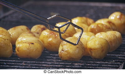 Young Potatoes Prepare on a Grill in Slow Motion - Young...