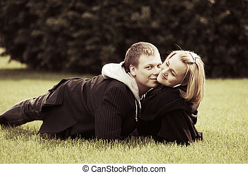 Happy young couple relaxing on nature