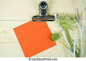 orange note paper on clipboard - orange square note paper on...