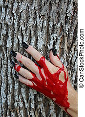 Bloody Hand on Tree - Woman's bloody hand with long black...
