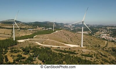 Aerial view of energy producing wind turbines, Portugal -...