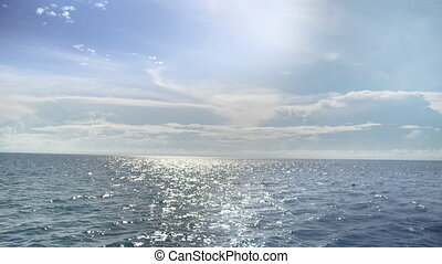 A wide shot of the sky and ocean's horizon
