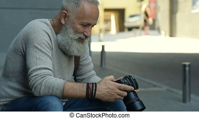 Cheerful amateur photographer taking photos in downtown -...