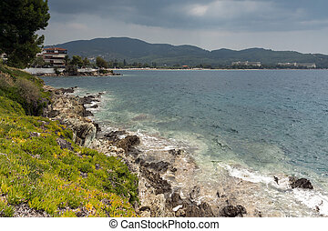 Panoramic view of coastline of town of Neos Marmaras at...
