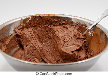 Chocolate icing in mixing bowl - Chocolate icing in a mixing...