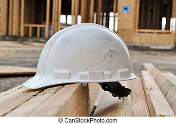 Hard Hat at Construction Site - Hard Hat at New Home...