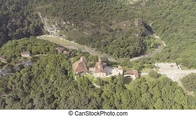 AERIAL. Old monastery hiding in the forests, also known as...