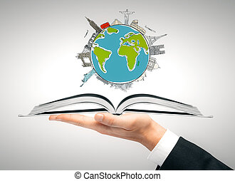Sightseeing concept - Hand holding open book with traveling...