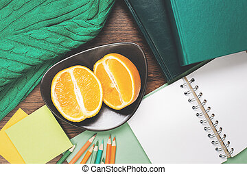 Empty notepad and fruit on table - Top view of wooden table...