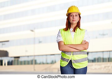 Young female architect/construction engineer at a...