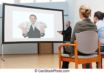 business meeting with presentation on a white screen