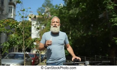 Male vaper with bicycle dreaming while walking - What if....