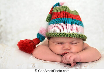 Sleeping baby - A sleeping baby girl wearing a striped hat