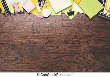 Empty dark wood desktop with supplies - Top view and close...