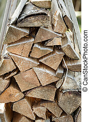 Single pieces of wood stacked to a heap