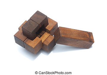 Wooden Brain Teaser or Wooden Puzzles on white floor and...