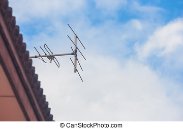 TV antenna on roof of house.