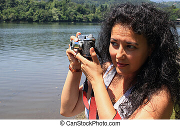 A young woman with an old camera