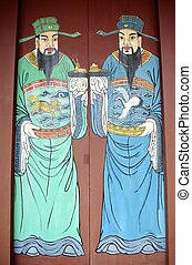 door-gods - Old wooden door with Chinese door-gods on