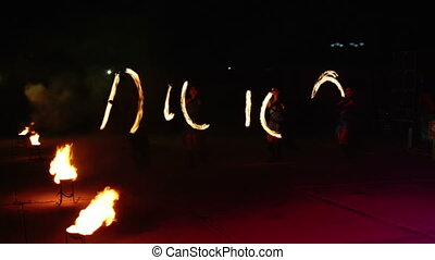 Abstract image of pulsating lights on fire show at night.