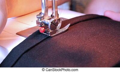 Sewing machine working part with dark cloth
