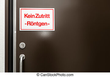 sign with german words which means no entrance, x-ray or...