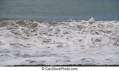 Storm on the Sea. The Waves are Rolling on a Pebble Stone...