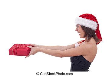 Girl giving christmas present