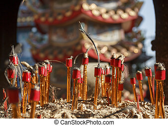 Chinese ritual candles after ceremony in temple.