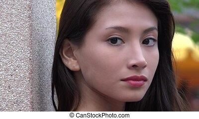 Serious Pretty Female Teen