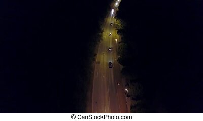Aerial down view shot of a rural European car road at night...