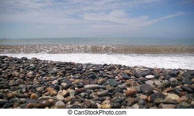 Big Waves Crashing on Stone Beach. Slow Motion