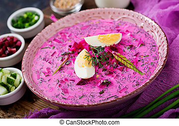 Cold beetroot (beet) soup on yogurt with egg, onion and...