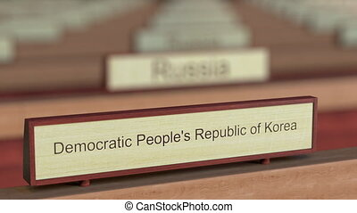 Democratic People's Republic of Korea DPRK name sign among...