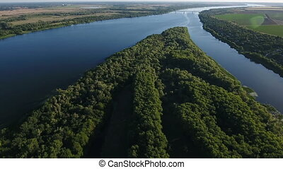 Aerial shot of the Dnipro river with wild greenary and wide...