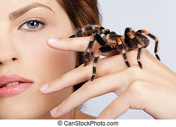 girl with spider - close-up portrait of girl with...