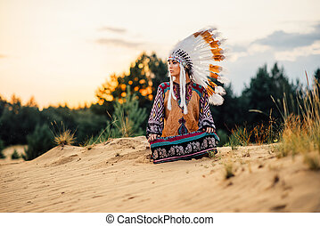 American Indian woman sitting in yoga pose